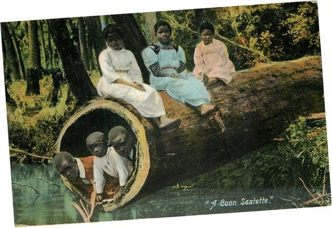 "Black Americana Postcard ""A Coon Sexteete"" Black Children on log"