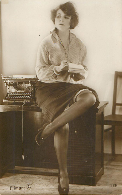 Receiptionist sitting on desk with typewriter - French Risque - Click Image to Close