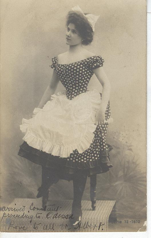 Girl wearing a polka dot dress and an apron