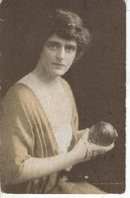 Brown haired girl holding a ball.