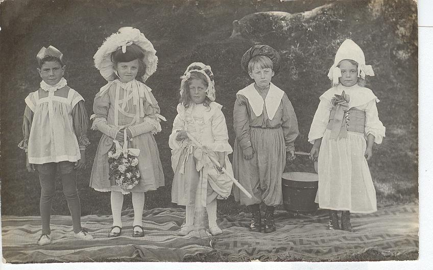 Five Small Children Dressed on stage