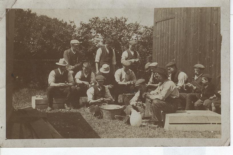 Farm Workers Sitting For A Break