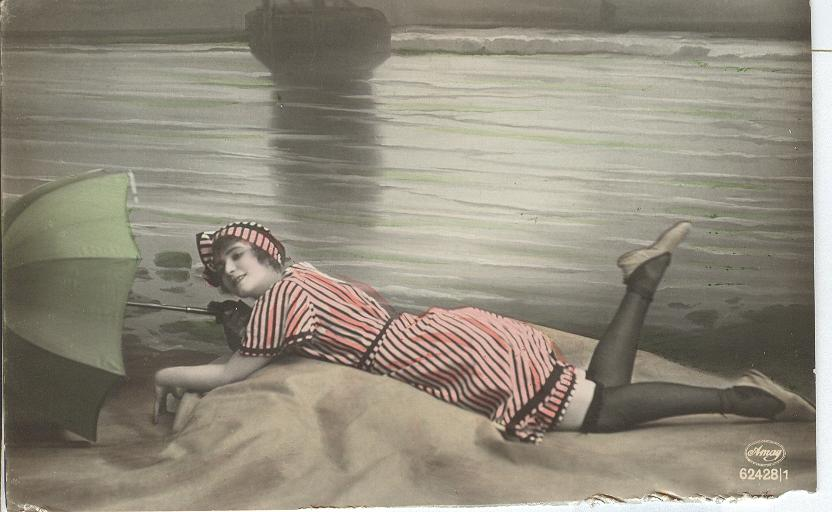 Woman lying on the beach with umbrella, silk stockings.