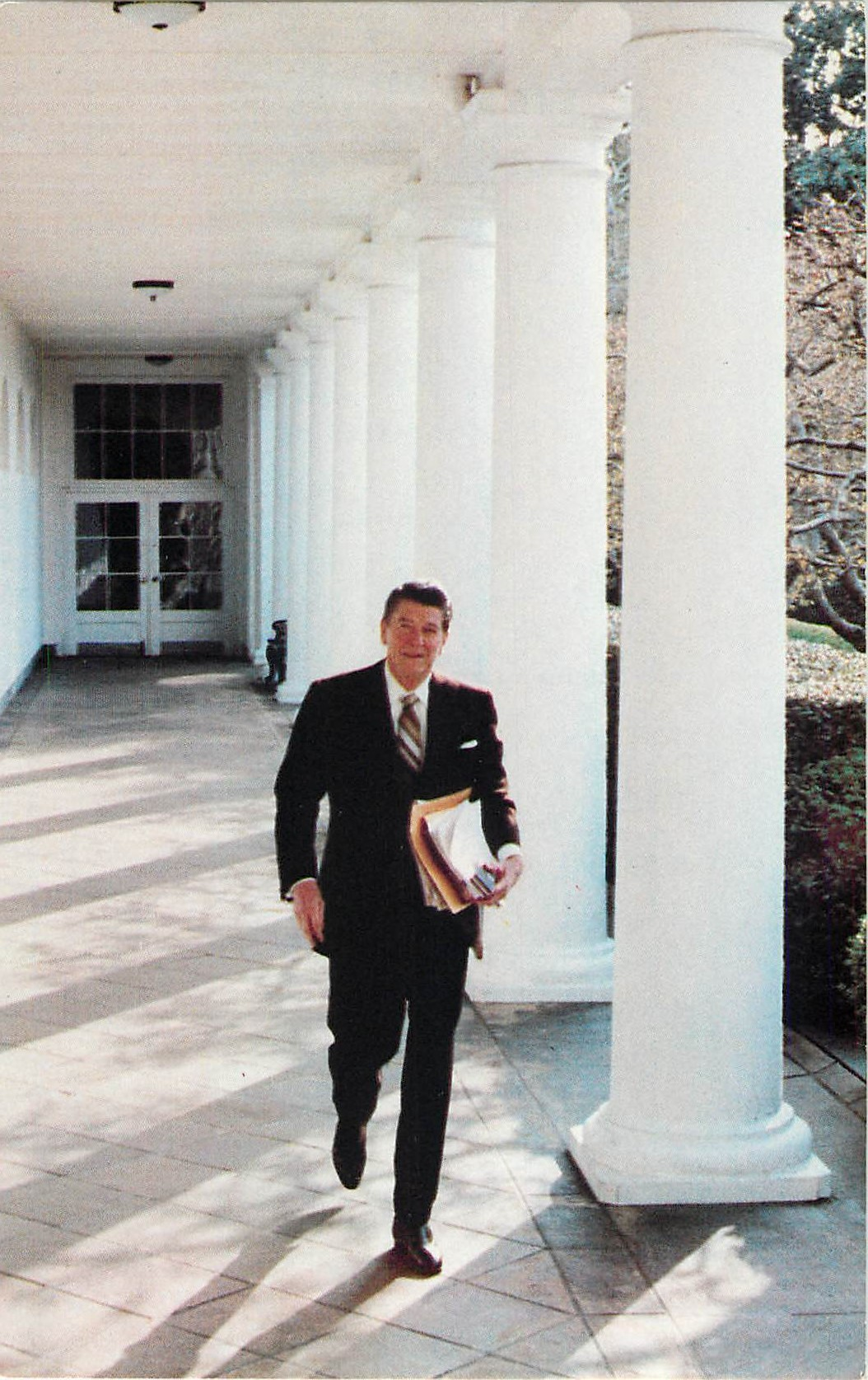 """President Reagan walking the Rose Garden Colonnade"""