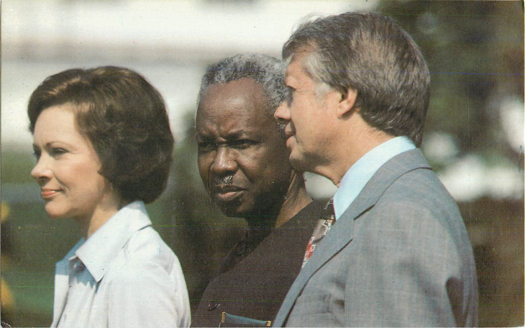 """Julius K. Nyerere with President and Mrs. Carter"""